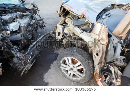 Creased hoods with bare motors of two collided cars after horrible accident - stock photo