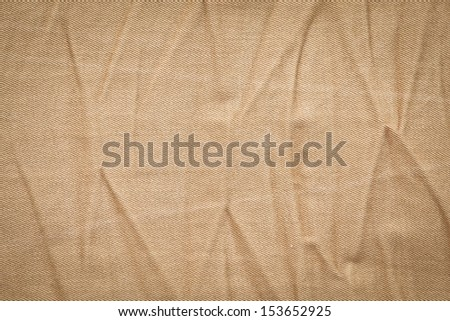 Creased khaki denim material as a background - stock photo