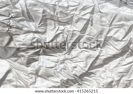 Creased white cloth background - stock photo