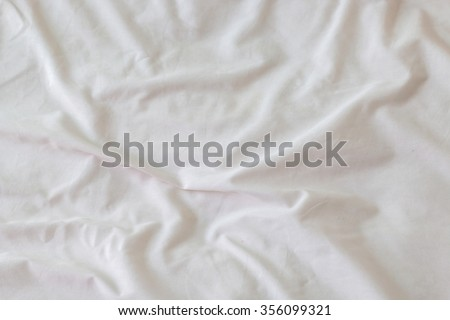 Creased white cloth material fragment as a background - stock photo