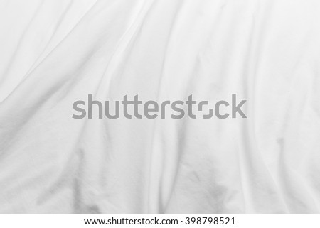 creased white cloth material fragment as a background. - stock photo