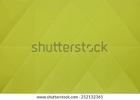 Creased yellow paper - stock photo