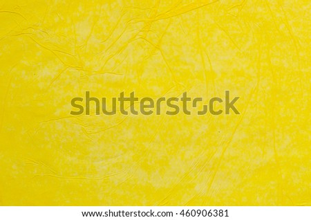 creased yellow tissue paper background texture