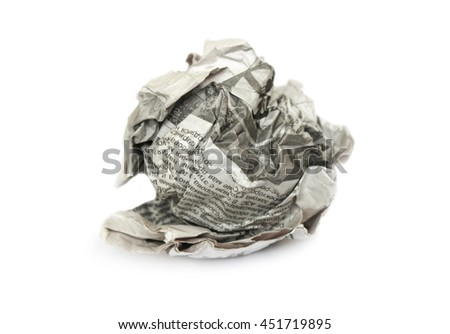 Creasy newspaper into a ball leaves isolated on white