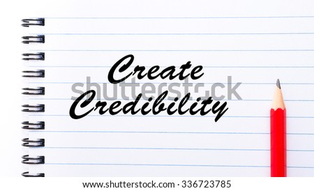Create Credibility written on notebook page, red pencil on the right. Motivational Concept image