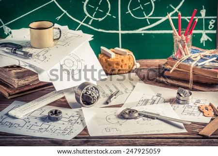 Create mechanical parts on paper - stock photo