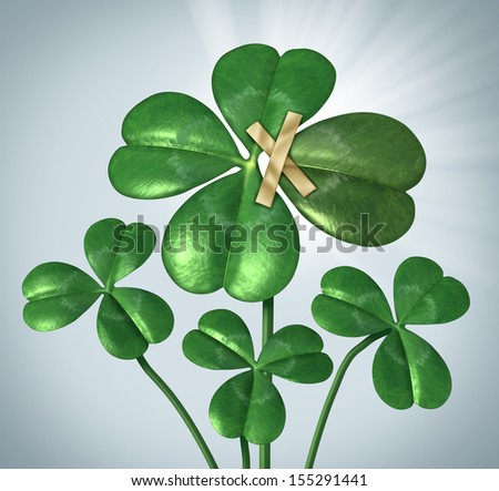 Create your success and taking control of your destiny with a three leaf clover being changed to good luck four leaves by taping an extra petal to the plant as a business concept  of  empowerment. - stock photo