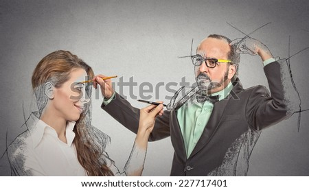 Create yourself, future destiny, image career. Attractive woman, middle aged guy drawing picture sketch of each other by memory isolated grey background. Human face expression determination creativity - stock photo