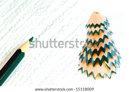 Creating a christmas card with a pencil and pencil sharpener - stock photo