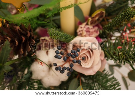 Creating a wonderful composition of cotton, cones, fir, magical variety carnations and delicious varieties of roses.