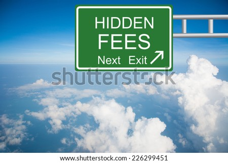 Creative a HIDDEN FEES Road Sign concept - stock photo