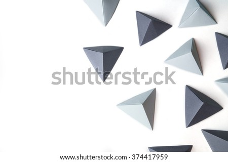 Creative abstract background with black and gray origami pyramids  with free copy space on the left side. Great for using in web. - stock photo