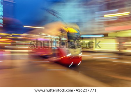 Creative abstract city transportation and business travel technology industrial concept: red tram on urban city street with motion blur effect.