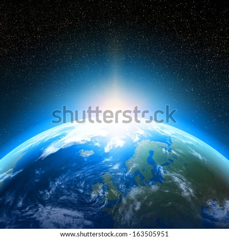 Creative abstract global communication scientific concept: space view of sunrise above Earth planet globe with world map in Solar System of Universe - stock photo