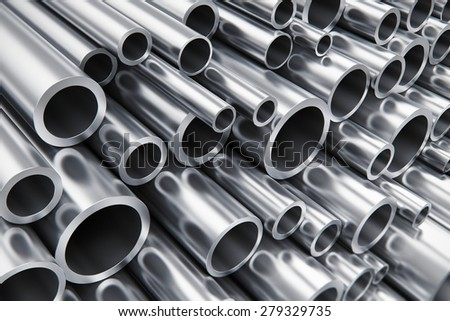 Creative abstract heavy metallurgical industry and industrial manufacturing business production concept: heap of shiny metal steel pipes with selective focus effect - stock photo