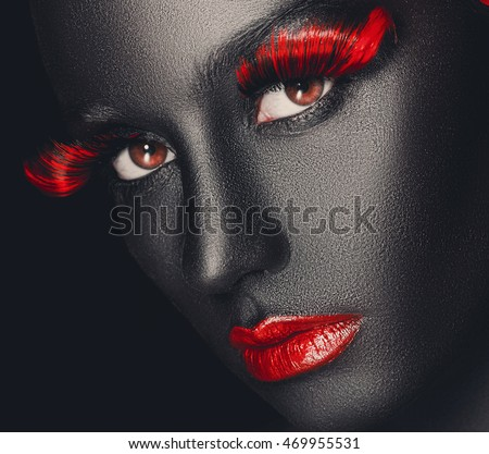 creative and fashion portrait of a dark-skinned girl with color make-up