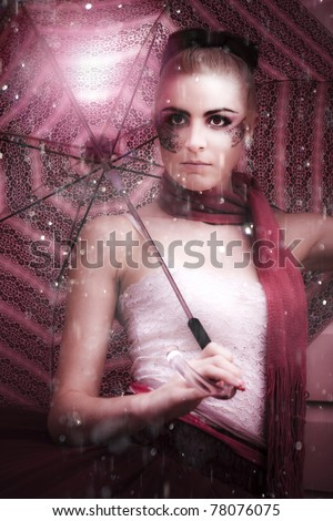 Creative And Inspiring Glamorous Fashion Model With Stylish Makeup Stands Out In The Pouring Rain With Umbrella During A Glamour Fashion Storm - stock photo