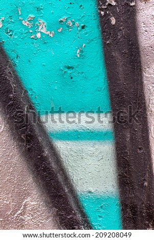 Creative arts background stone age textured wall painted with colored inks. Abstract graffiti. green white black gray blue colors