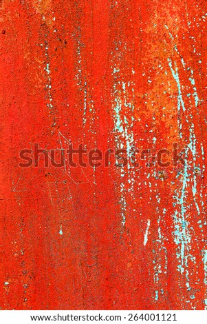 Creative background of rusty metal with cracks and scratches, carelessly painted red paint. Grungy metal surface. Great background or texture for your project. - stock photo