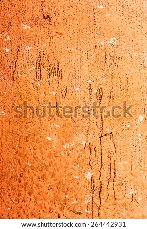 Creative background old concrete wall paint orange paint, stains water stains, cracks and scratches. Grungy concrete surface. Great background or texture for your project.