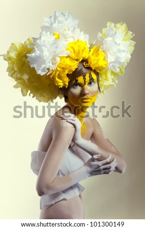 Creative beauty shot with yellow headdress