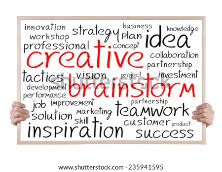 creative brainstorm and other related words handwritten on whiteboard with hands - stock photo