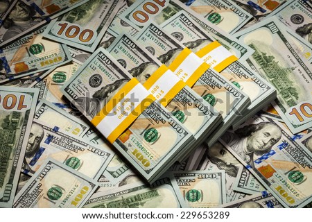 Creative business finance making money concept - background of of new 100 US dollars 2013 edition banknotes (bills) bundles close up - stock photo