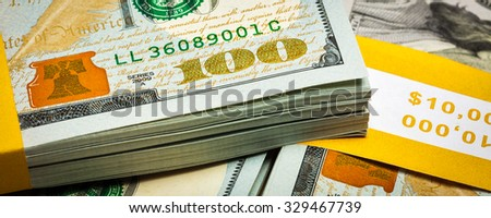 Creative business finance making money concept - letterbox panoramic image of new 100 US dollars 2013 edition banknotes (bills) bundles close up - stock photo