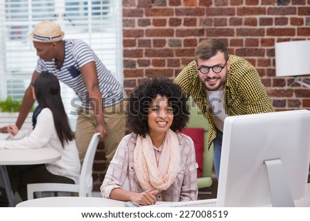 Creative business people using computer at office - stock photo