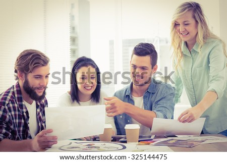 Creative business people working at desk in office - stock photo