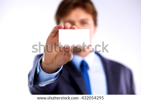 creative businessman holding out his business card - stock photo