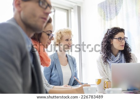 Creative businesspeople in meeting at office - stock photo