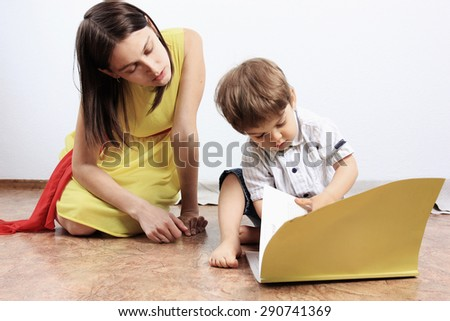 Creative child or mother and son, Small boy reading a book, Reading magazine, Mother and child, Child education, Education process, Clever kids, Be smart  - stock photo