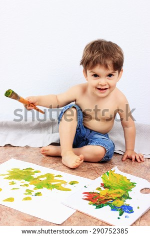 Creative child or Painting, Clever child, Art school, Art therapy, Art studio, Painting brush, Happy child, Happy boy, Art lessons - stock photo