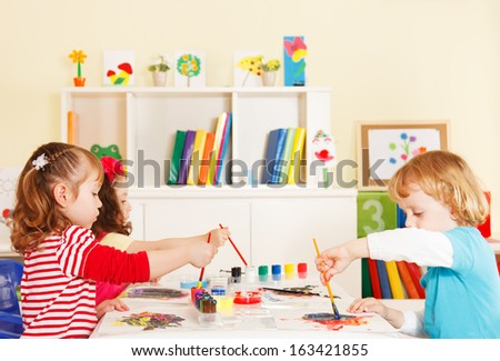 Creative children choosing a color - stock photo