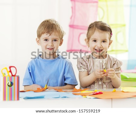 Creative children playing with craft - stock photo