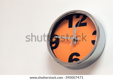 Creative Clock. Watch with an orange dial. It's near dinner time. - stock photo