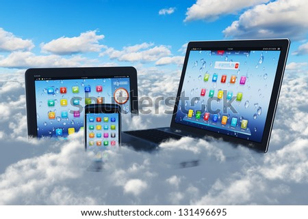 Creative cloud computing concept: modern laptop notebook, tablet computer PC and black glossy touchscreen smartphone in the blue sky with clouds - stock photo