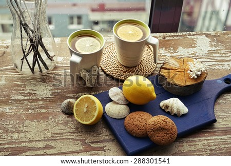 creative composition of two cups of hot tea with decoration around  - stock photo