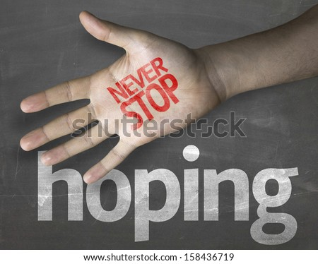 """Creative composition with the message """"Never Stop Hoping"""" - stock photo"""