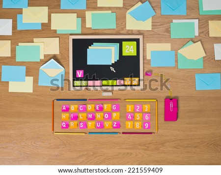 Creative computer composed of colorful stationery items on the floor. - stock photo