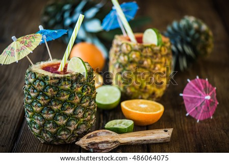 creative concept for tropical party drinks, pineapple exotic coctail