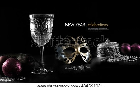Creative concept image for New Year celebrations. Festive elements against a black background with generous accommodation for copy space. The perfect image for your New Year party invitations.
