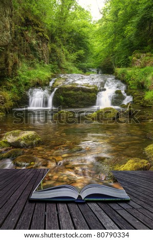 Creative concept image of flowing forest waterfall coming out of pages in magical book - stock photo