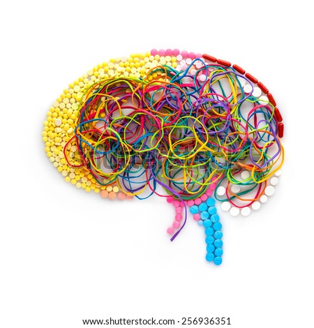 Creative concept of a human brain made of drugs, pills and colorful rubber bands as a memory illustration.