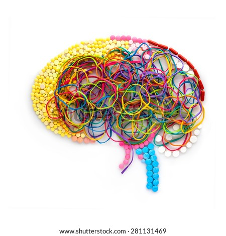 Creative concept of a human brain made of drugs, pills and colorful rubber bands as a memory illustration. - stock photo