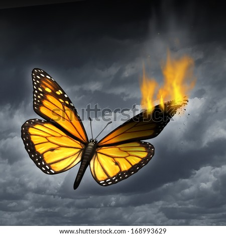 Creative crisis business concept as a monarch butterfly in distress with a burning wing as a metaphor for problems in creativity and managing human sadness and depression. - stock photo