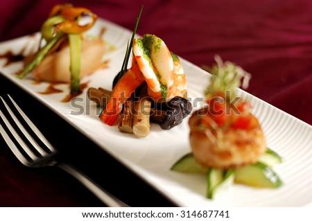 Creative Cuisine Appetizer Shrimp Seafood. Shrimp appetizers during a party. - stock photo