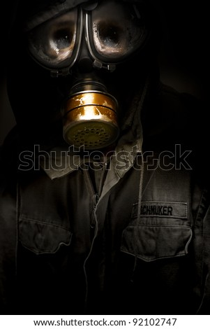 Creative Dark Photograph Of A Dead German Soldier With Rotten Sunken Face Wearing A Faulty Leaking Gasmask In A Casualties Of War Conceptual - stock photo