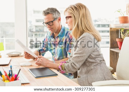 Creative design team brainstorming in the office - stock photo